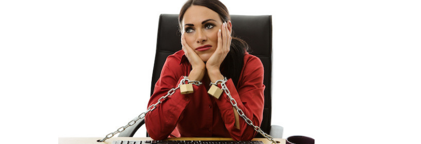 Woman executive chained to desk